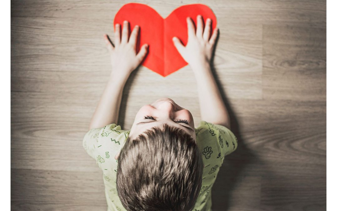 boy with paper heart