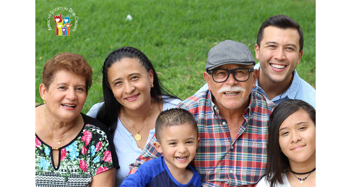 image shows a happy multigenerational Latinx family