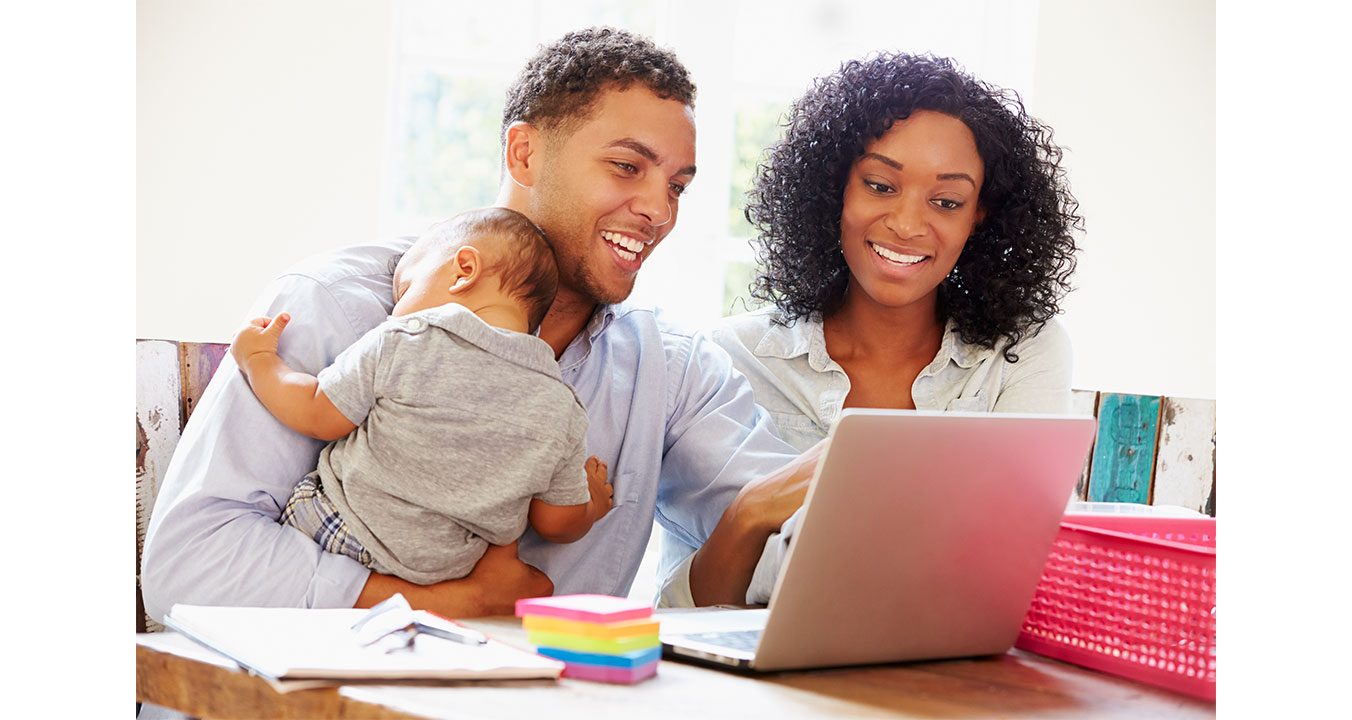 ASDC newsletters - image shows a happy couple with their infant looking at a computer screen