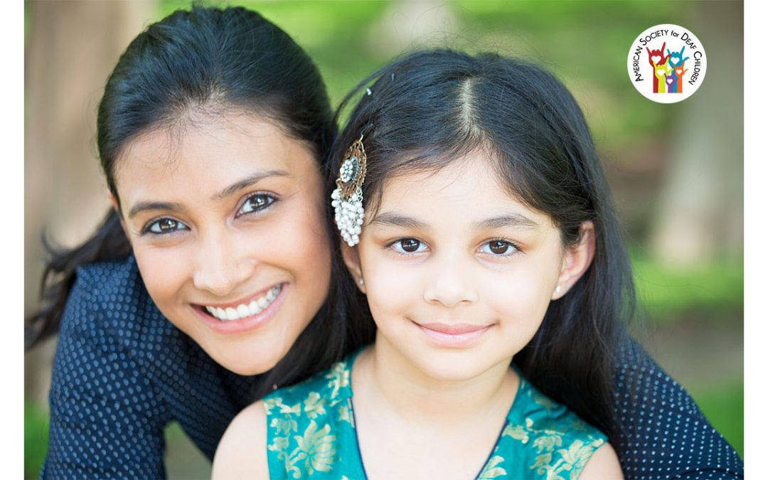 images shows a happy Latina mother and daughter