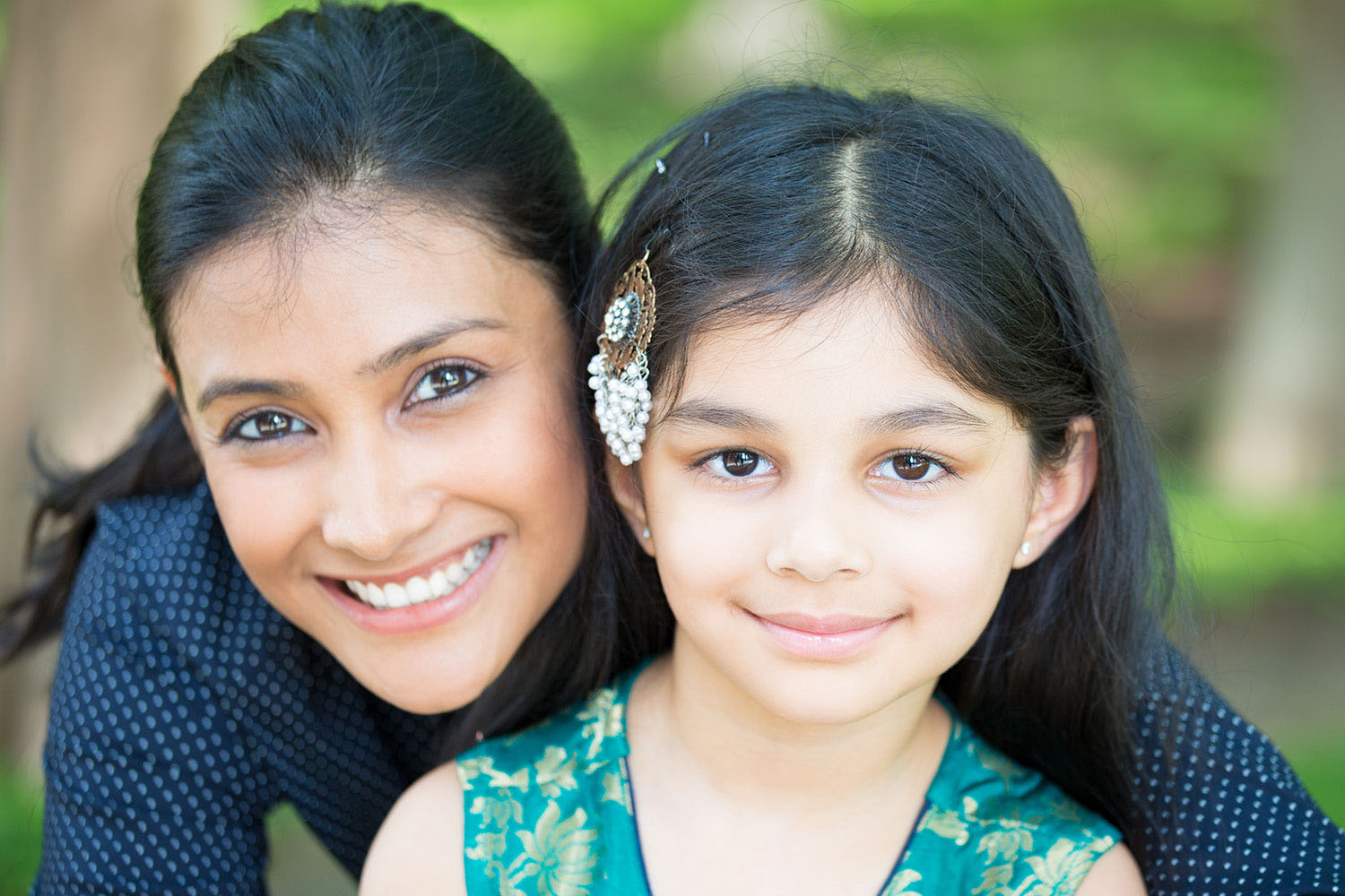 image shows a happy Latina mother and her daughter