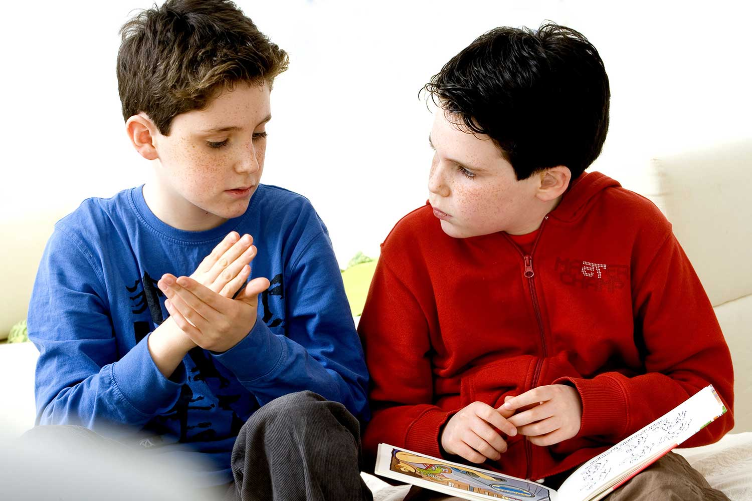 two brothers are reading and signing together