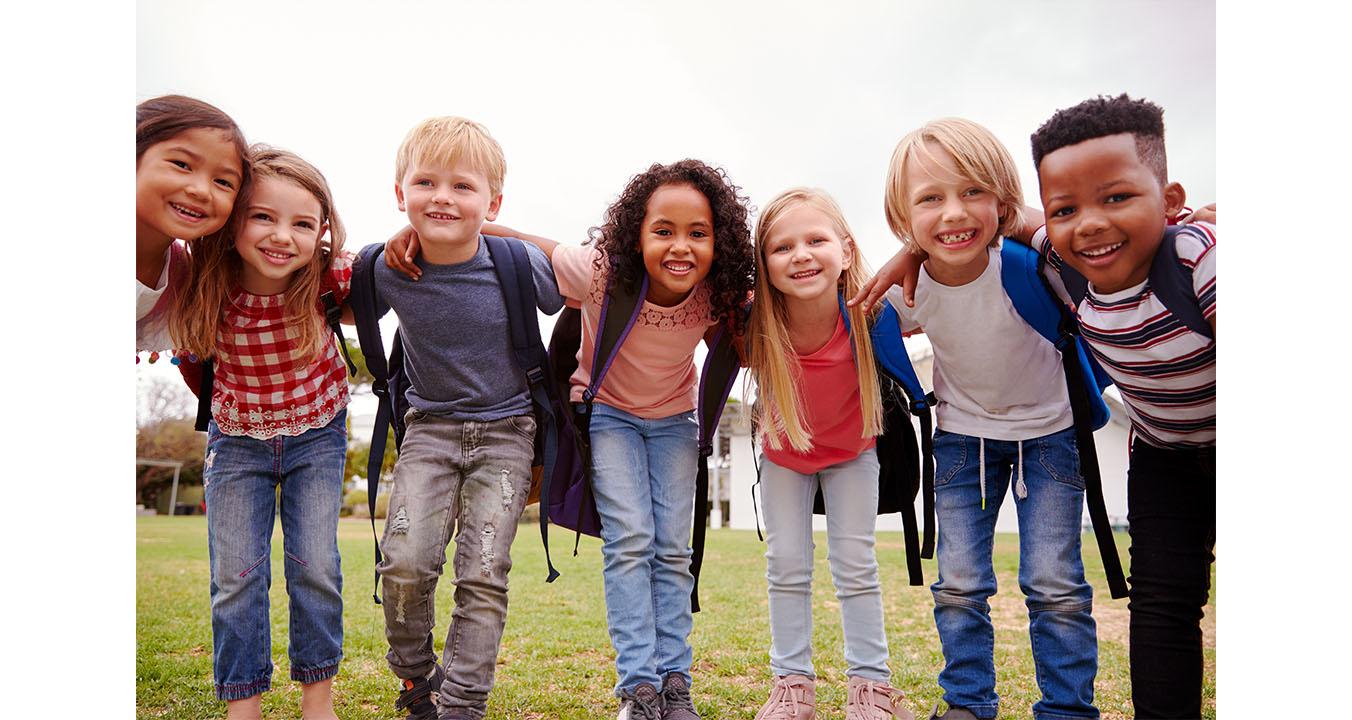 happy school children on the playground